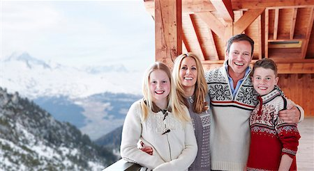 Family smiling on balcony together Stock Photo - Premium Royalty-Free, Code: 6113-07790624