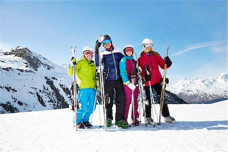 Family carrying skis on mountain top Stock Photo - Premium Royalty-Free, Code: 6113-07790628