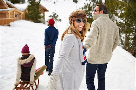 Family walking through the snow together Stock Photo - Premium Royalty-Free, Code: 6113-07790633