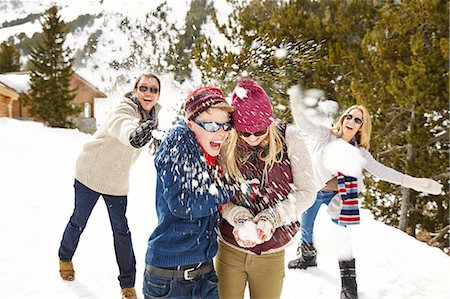 Family having snowball fight together Stock Photo - Premium Royalty-Free, Code: 6113-07790638