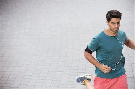 runner (male) - Man running through city streets Stock Photo - Premium Royalty-Free, Code: 6113-07790749
