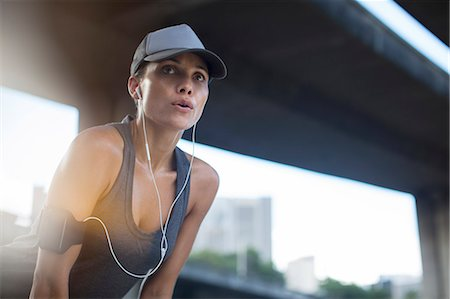 fit people - Woman resting after exercising on city street Stock Photo - Premium Royalty-Free, Code: 6113-07790771