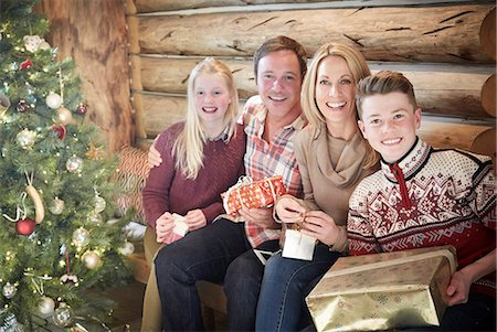 Family opening gifts on Christmas Stock Photo - Premium Royalty-Free, Code: 6113-07790701
