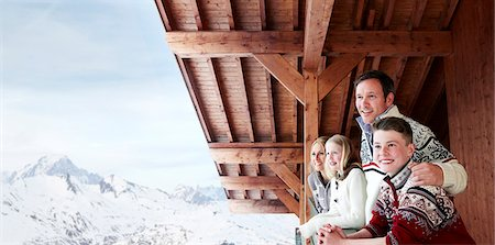 Family looking out from the balcony together Stock Photo - Premium Royalty-Free, Code: 6113-07790708