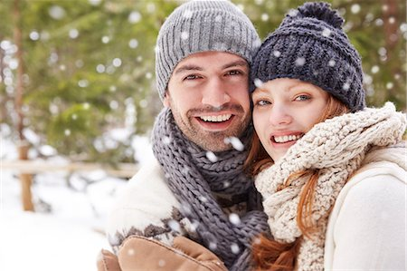 snowflakes  holiday - Couple hugging in snow Stock Photo - Premium Royalty-Free, Code: 6113-07790711