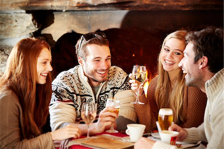 restaurant - Friends enjoying drinks together Stock Photo - Premium Royalty-Free, Code: 6113-07790715