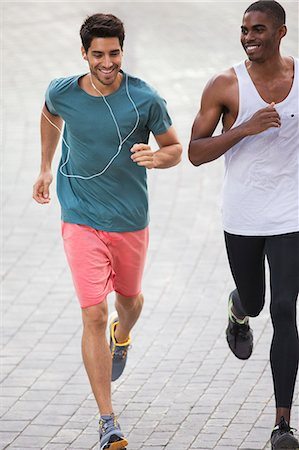 runner (male) - Men running through city streets together Stock Photo - Premium Royalty-Free, Code: 6113-07790827