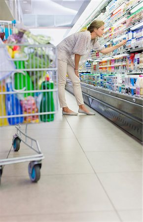 selecting - Woman examining products in grocery store Stock Photo - Premium Royalty-Free, Code: 6113-07790954
