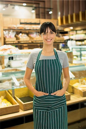 Clerk smiling at grocery store deli counter Stock Photo - Premium Royalty-Free, Code: 6113-07790960