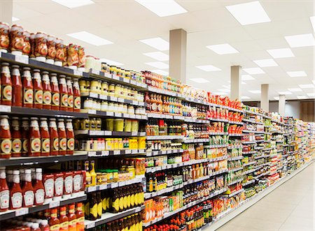 supermarket not people - Stocked shelves in grocery store aisle Stock Photo - Premium Royalty-Free, Code: 6113-07790970