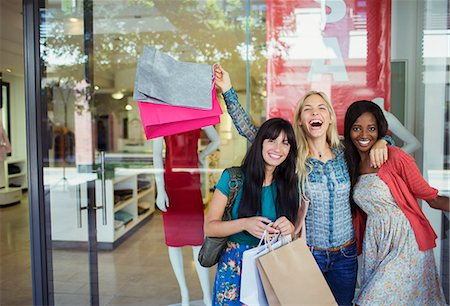 people on mall - Women carrying shopping bags outside clothing store Stock Photo - Premium Royalty-Free, Code: 6113-07791064