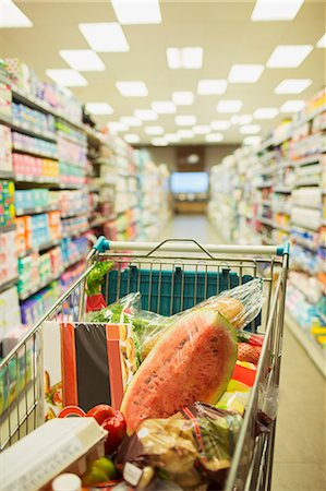 Full shopping cart in grocery store aisle Stock Photo - Premium Royalty-Free, Code: 6113-07791077
