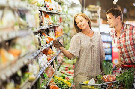 Couple shopping together in grocery store Stock Photo - Premium Royalty-Free, Code: 6113-07791074
