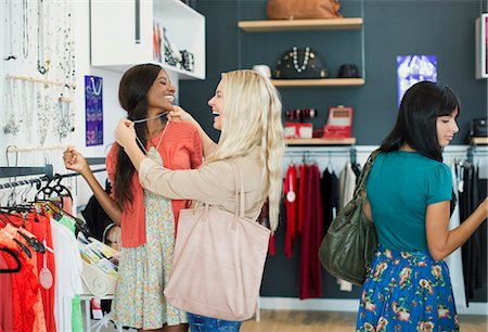 Women shopping together in clothing store Stock Photo - Premium Royalty-Free, Code: 6113-07791078