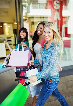 shopping mall - Women carrying shopping bags in shopping mall Stock Photo - Premium Royalty-Free, Code: 6113-07791081
