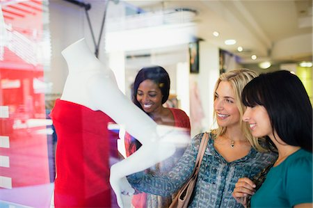 Women shopping together in clothing store Stock Photo - Premium Royalty-Free, Code: 6113-07791082
