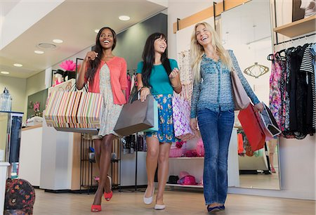 Women shopping together in clothing store Stock Photo - Premium Royalty-Free, Code: 6113-07791090