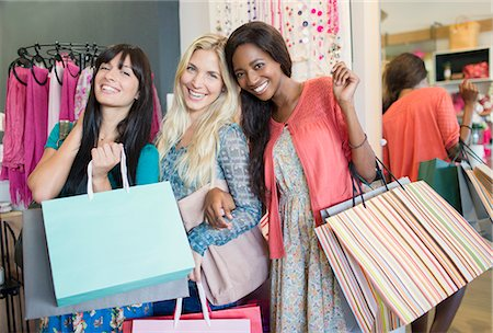 Women shopping together in clothing store Stock Photo - Premium Royalty-Free, Code: 6113-07791095