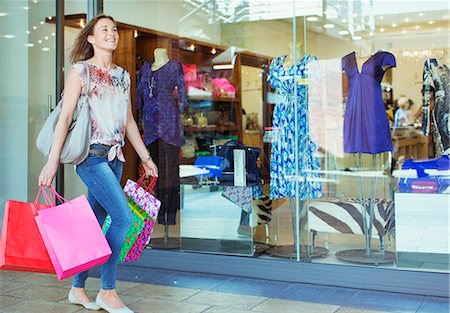 shopping mall - Woman carrying shopping bags in shopping mall Stock Photo - Premium Royalty-Free, Code: 6113-07791020