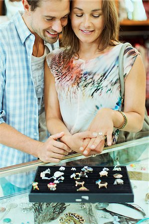 Couple admiring jewelry together in store Stock Photo - Premium Royalty-Free, Code: 6113-07791036