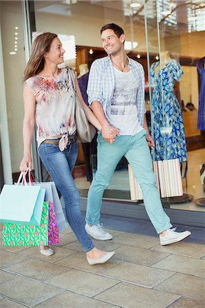 people on mall - Couple shopping together in shopping mall Stock Photo - Premium Royalty-Free, Code: 6113-07791158