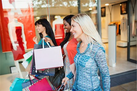 shopping mall - Women carrying shopping bags in shopping mall Stock Photo - Premium Royalty-Free, Code: 6113-07791174