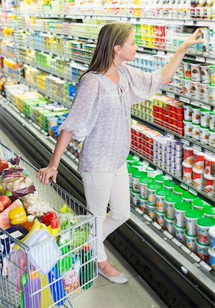 food - Woman shopping in grocery store Stock Photo - Premium Royalty-Free, Code: 6113-07791180