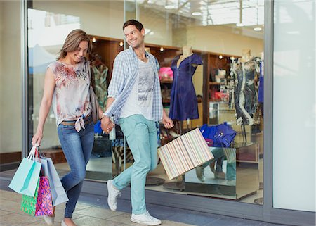 shopping mall - Couple carrying shopping bags in shopping mall Stock Photo - Premium Royalty-Free, Code: 6113-07791113