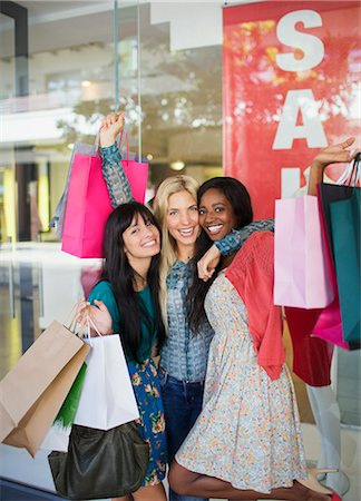 sale - Women holding shopping bags outside clothing store Stock Photo - Premium Royalty-Free, Code: 6113-07791111