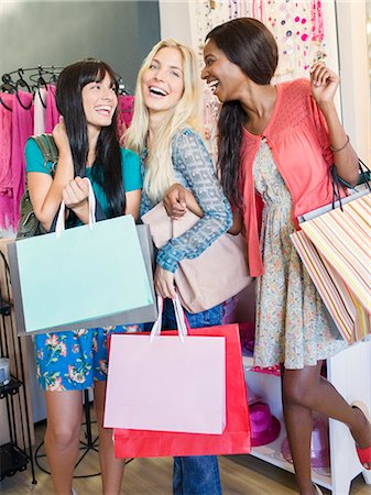 Women carrying shopping bags in clothing store Stock Photo - Premium Royalty-Free, Code: 6113-07791123