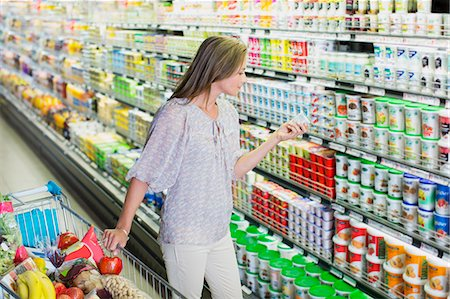 Woman shopping in grocery store Stock Photo - Premium Royalty-Free, Code: 6113-07791126