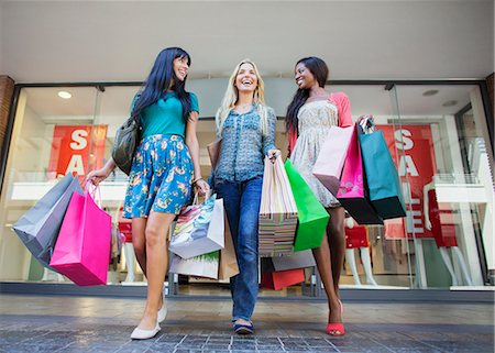 people on mall - Low angle view of women carrying shopping bags outside clothing store Stock Photo - Premium Royalty-Free, Code: 6113-07791132