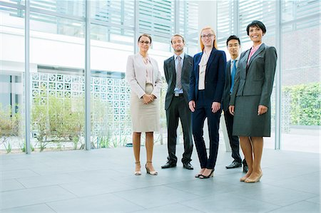 partnership - Business people gathered in office building Stock Photo - Premium Royalty-Free, Code: 6113-07791256