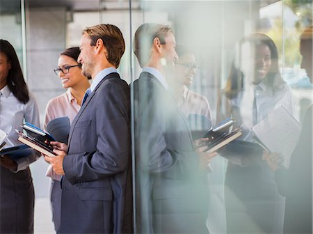 Business people talking in office building Stock Photo - Premium Royalty-Free, Code: 6113-07791271