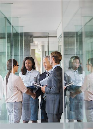 Business people talking in office building Stock Photo - Premium Royalty-Free, Code: 6113-07791285