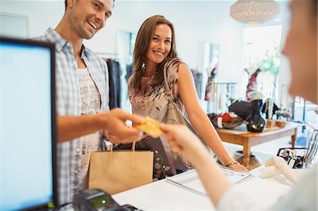purchase - Couple paying with credit card in clothing store Stock Photo - Premium Royalty-Free, Code: 6113-07791202