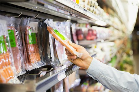 Man selecting product in grocery store Stock Photo - Premium Royalty-Free, Code: 6113-07791217