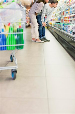 Couple shopping together in grocery store Stock Photo - Premium Royalty-Free, Code: 6113-07791226