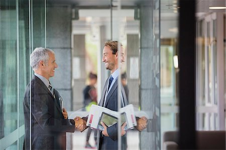 Businessmen shaking hands in office building Stock Photo - Premium Royalty-Free, Code: 6113-07791304