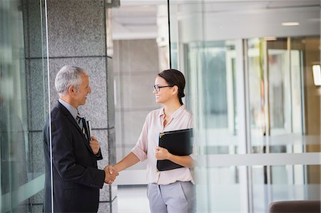 Business people shaking hands in office building Stock Photo - Premium Royalty-Free, Code: 6113-07791305