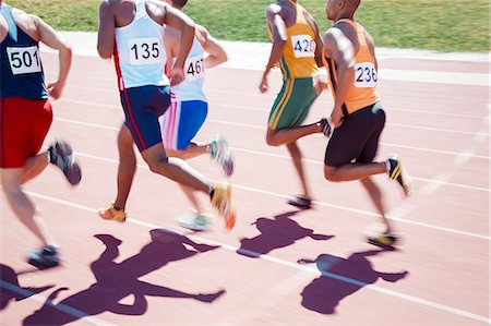 Runners racing on track Stock Photo - Premium Royalty-Free, Code: 6113-07730463
