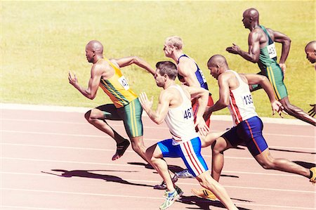 race track (people) - Sprinters racing on track Stock Photo - Premium Royalty-Free, Code: 6113-07730460