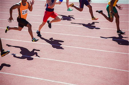 race track (people) - Runners racing on track Stock Photo - Premium Royalty-Free, Code: 6113-07730466
