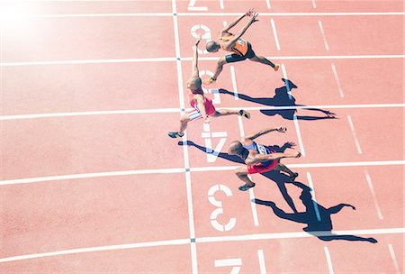 sprint - Runners crossing finish line on track Stock Photo - Premium Royalty-Free, Code: 6113-07730469