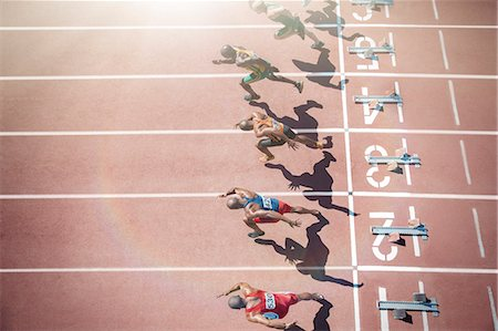 race track (people) - Runners taking off from starting blocks on track Stock Photo - Premium Royalty-Free, Code: 6113-07730484