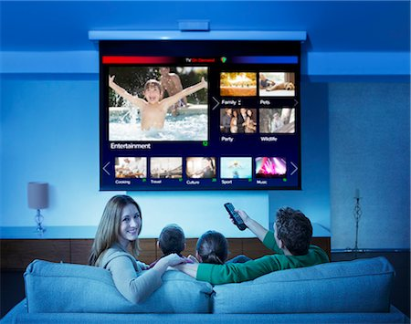 Family watching television in living room Stock Photo - Premium Royalty-Free, Code: 6113-07730541