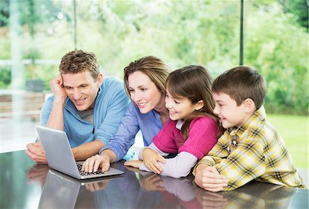 Family using laptop together Stock Photo - Premium Royalty-Free, Code: 6113-07730546