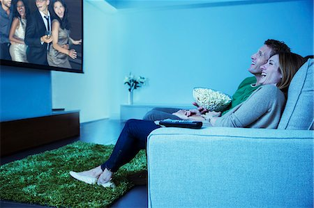 Couple watching television in living room Stock Photo - Premium Royalty-Free, Code: 6113-07730558