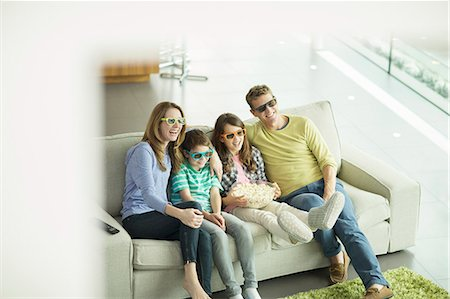 Family watching 3D television in living room Stock Photo - Premium Royalty-Free, Code: 6113-07730559