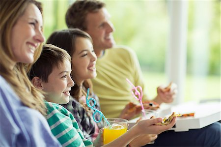 Family watching television in living room Stock Photo - Premium Royalty-Free, Code: 6113-07730561